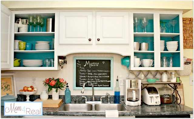 Open Cabinets With White, Aqua, Lime Green, & Silver Accents