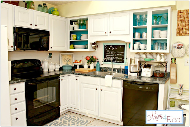 Open Kitchen Cabinets with Aqua Accents at www.mom4real.com