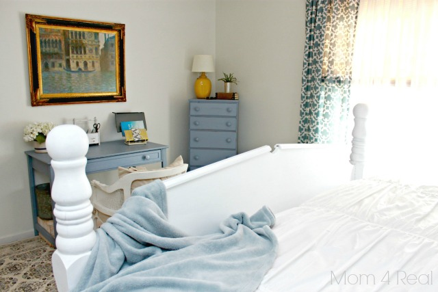 Blue and white cottage bedroom with workspace