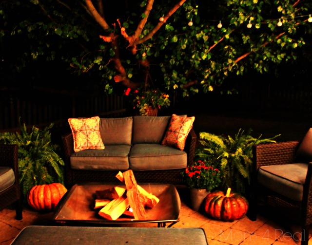 Patio with firepit and tree