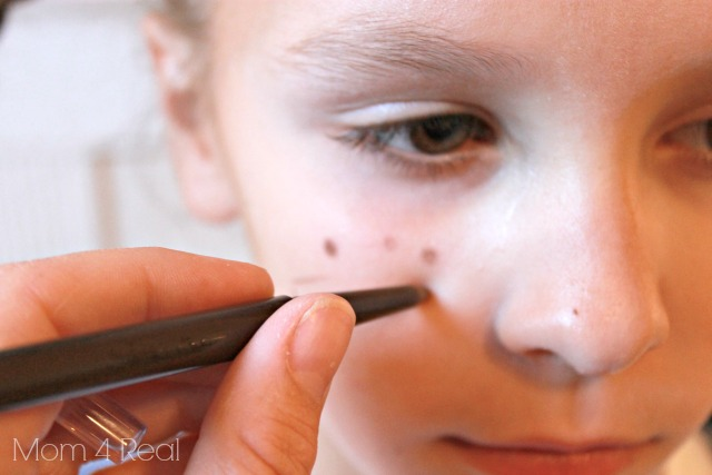 Use Eyeliner to add freckles
