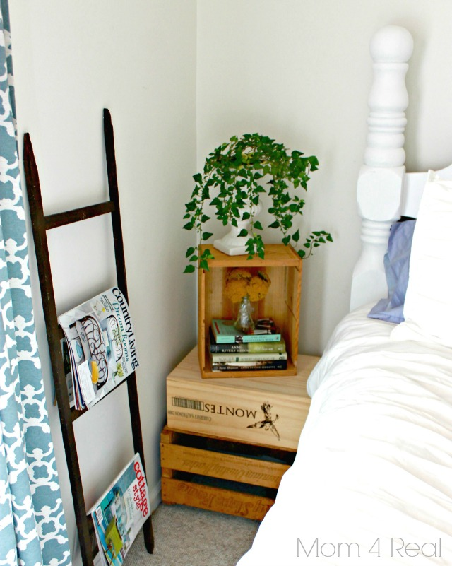 Use wine crates to create a bedside table in a cottage style bedroom