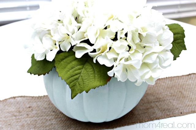 Paint a foam pumpkin and turn it into a planter or vase