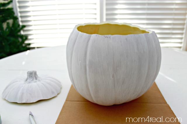 Paint a foam pumpkin planter