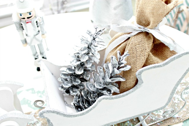 Sled with Burlap Sack and Silver Pinecones