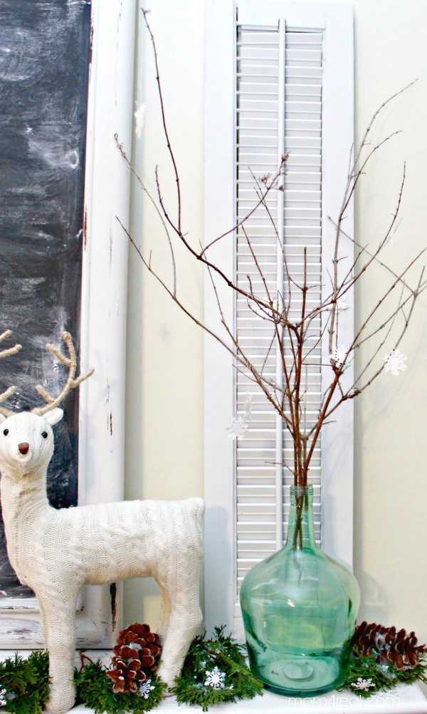 Snowflakes on twigs in a vase