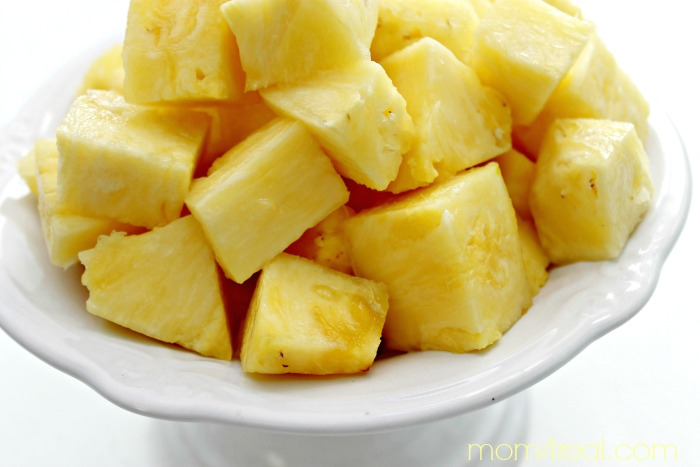 The easiest way to cut a pineapple into squares or chunks