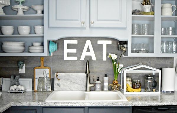 Grey kitchen with planked backsplash at mom4real.com