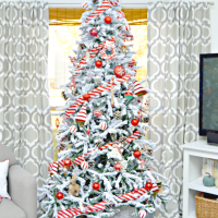 Red and White Candy Cane Themed Flocked Christmas Tree