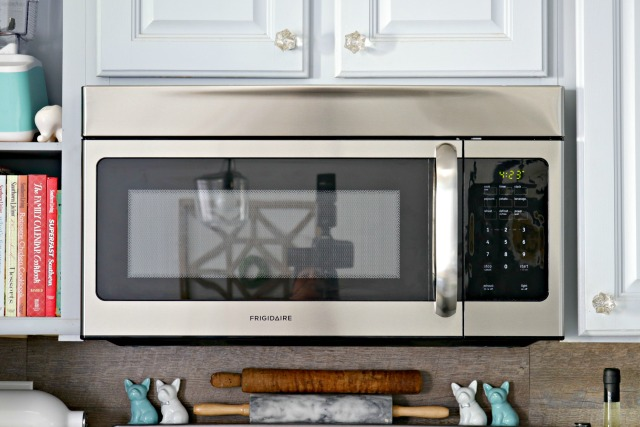 microwave in grey kitchen with teal accents