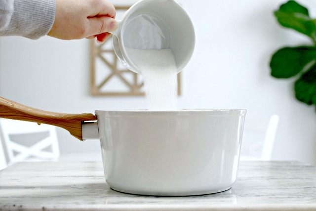 pouring sugar into a pot