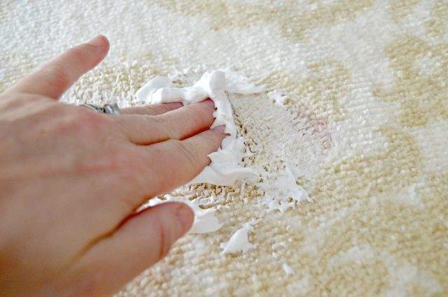 applying shaving cream to red wine stain