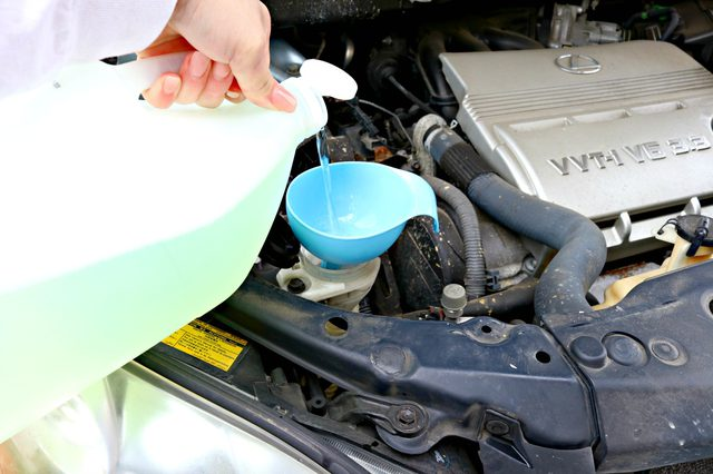 adding windshield washer fluid to your car