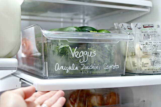 Clear plastic bin storing vegetables.
