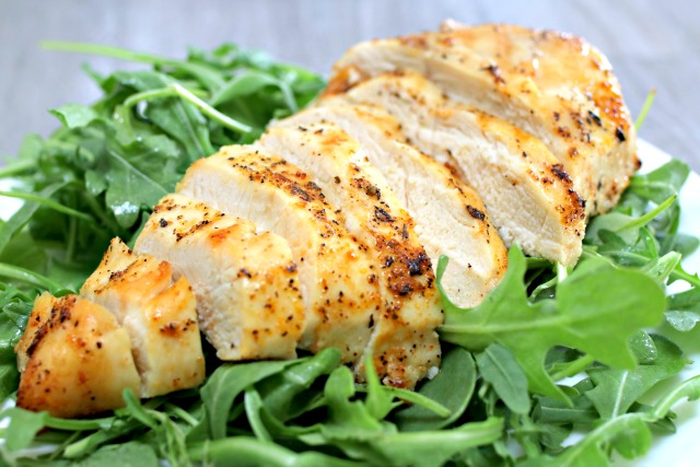 grilled chicken on arugula