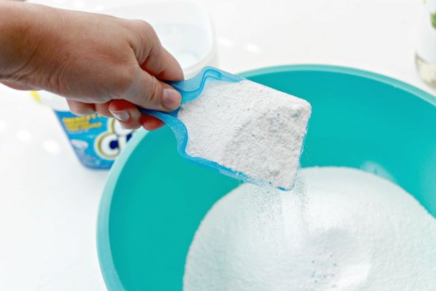 oxiclean being poured into a bowl