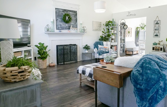 living room decorated with grey and white home decor