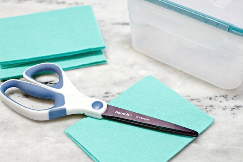 scissors cutting a microfiber cloth