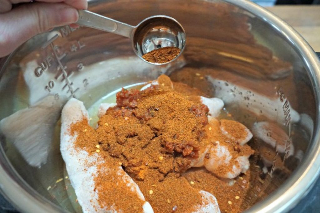 frozen chicken in Instant Pot with taco seasoning