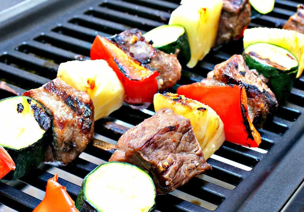 steak kabobs with pineapple, red peppers and zucchini