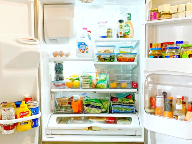 organized refrigerator with removable plastic bins