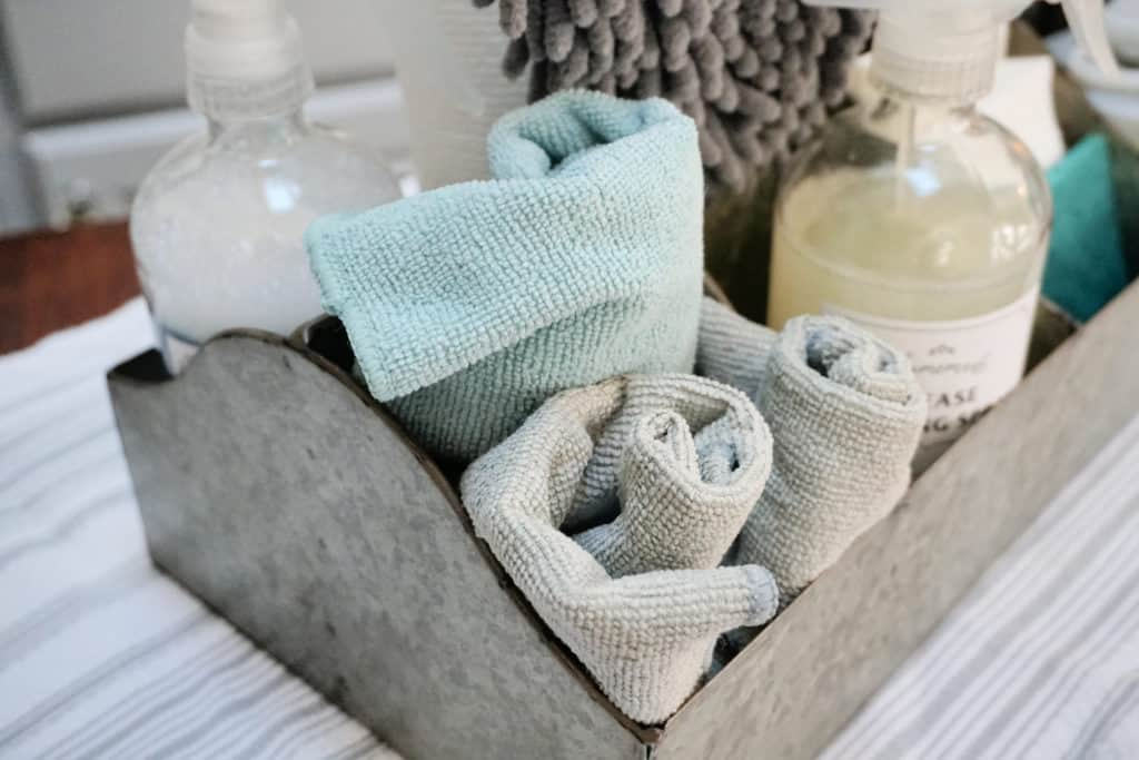 microfiber cleaning cloths in a cleaning caddy