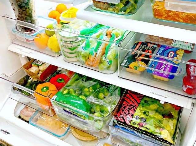 organized refrigerator with crisper drawers removed using clear plastic bins